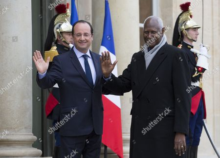 French President Francois Hollande (l) Greets Secretary General of Francophone Affairs Abdou Diouf (r) Before a Meeting As Part of the Week of French Language and Francophone Affairs at the Elysee Palace in Paris France 18 March 2014 France Paris