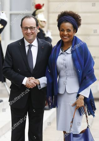 French President Francois Hollande (l) Poses with 'La Francophonie' the French-speaking Countries' General Secretary Michaelle Jean (r) As She Arrives For a Meeting at the Elysee Palace in Paris France 18 February 2015 the Haiti-born Canadian Journalist and Former Governor General of Canada Succeeded 'Francophonie' General Secretary Abdou Diouf As the Third Secretary-general of the 'Organisation Internationale De La Francophonie' in January 2015 France Paris