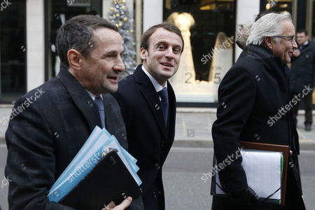 French Minister of Economy Industrial Renewal and Information Technology Emmanuel Macron (c) French Labour Minister Francois Rebsamen (r) and French Junior Minister to State Reform Thierry Mandon (l) Walk to the Elysee Palace to Attend the First French Cabinet Meeting of the Year in Paris France 05 January 2015 France Paris