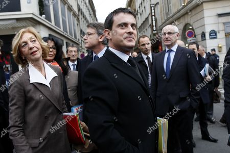 French Minister For Foreign Trade Nicole Bricq (l) Looks at French Interior Minister Manuel Valls (c) As They Leaves the Hotel Beauvau with Others French Government Ministers to Walk to the Elysee Palace to Attend the First Cabinet Meeting of the Year 2014 in Paris France 03 January 2014 France Paris