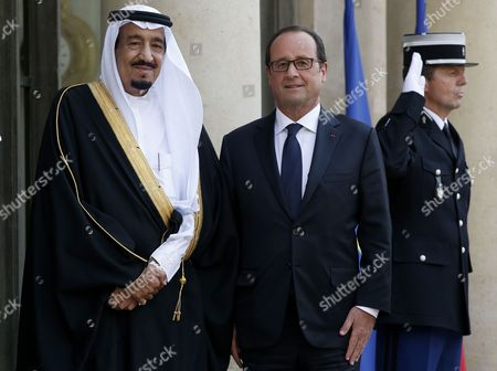 A File Picture Dated 01 September 2014 Shows French President Francois Hollande (c) Greeting Saudi Arabia's Prince Salman Bin Abdulaziz Al Saud (l) Prior Their Dinner Meeting at the Elysee Palace in Paris France Saudi State Tv Has Announced on 22 January 2015 That Saudi King Abdullah Bin Abdul Aziz who was Admitted to a Hospital in Riyadh with Pneumonia Has Died and Named Salman Bin Abdulaziz Al-saud As His Successor France Paris