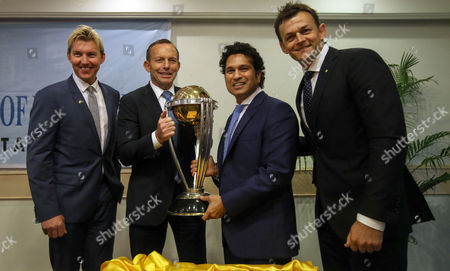 Former Australian Cricketer Brett Lee (l) Australian Prime Minister Tony Abbott (2l) Former Indian Cricketer Sachin Tendulkar (2r) Along with Former Australian Cricketer Adam Gilchrist (r) Pose with the Cricket World Cup Trophy at the Cricket Club of India in Mumbai India 04 September 2014 Abbott is on Two Day Official Visit to India to Strengthen Political and Bilateral Ties Between Two Countries the Cricket World Cup Will Be Held in Australia and New Zealand in 2015 India Mumbai