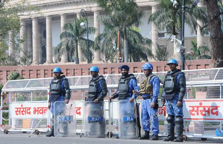 Indian Rapid Action Force (raf) Soldiers and Security Guards Stand Guard Outside Indian Parliament House on 17 February 2014 India's Finance Minister Palaniappan Chidambaram Presented the Government's Last Budget Before General Elections Due Later This Year Saying the Ruling Coalition Had Revived Growth and Reduced the Number of People in Poverty General Elections Are to Be Held by the End of May with the Next Government to Announce the Main Budget India New Delhi