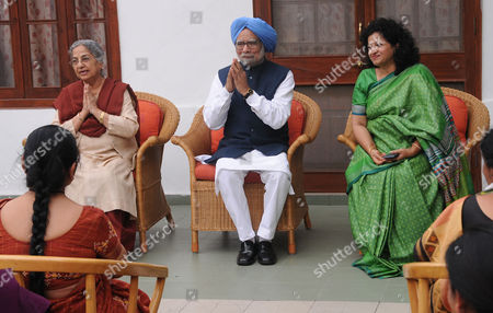 Former Indian Prime Minister Manmohan Singh (c) Greets Members of All India Mahila Congress During Their Visit with Their President (unseen) to Express Their Support with Him As Singh's Wife Gursharan Kaur (l) and President of the Group Shobha Ojha (r) Sit Nearby in New Delhi India 13 March 2015 India's Former Premier Manmohan Singh on 11 March 2015 was Summoned by a Court Investigating a Case Linked to a Multi-billion-dollar Coal Scandal Officials Said the Case Against Singh Involved the Alleged Misallocation of a Lucrative Coal Mining Licence Issued to Birla's Hindalco Industries in Orissa State in 2005 India New Delhi