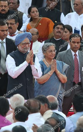 Outgoing Indian Prime Minister Manmohan Singh Arrives with His Wife Gursharan Kaur to Attend the Swearing-in Ceremony of Narendra Modi As the New Prime Minister of India at the Presidential Palace in New Delhi India on 26 May 2014 Narendra Modi was Sworn in As India's 15th Prime Minister on and Vowed to Build a 'Glorious Future' For the South Asian Country Modi 63 Took the Oath Before an Estimated 4 000 Guests Including His Counterpart From Rival Pakistan Nawaz Sharif on the Forecourt of the Presidential Palace in New Delhi India New Delhi