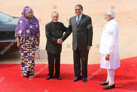 Stock Picture of Tanzania President Jakaya Kikwete (2-r) and His Wife Salma Kikwete (l) Are Welcomed by Indian President Pranab Mukherjee (2-l) As Indian Prime Minister Narandra Modi (r) Looks on During Their Welcome Reception at the Indian President's House in New Delhi India 19 June 2015 President Jakaya Kikwete is in India on His State Visit to Boost Bilateral and Business Ties Between the Two Countries India New Delhi