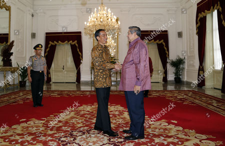 Indonesian President Joko Widodo (l) Greets the Chairman of Global Green Growth Institute (gggi) and Former President Susilo Bambang Yudhoyono Shortly Before a Meeting in Jakarta Indonesia 08 December 2014 Yudhoyono Met His Successor in a New Role As the Chairman of the Seoul-based Gggi to Promote Strategies For Environment-friendly Economic Growth in Developing and Emerging Countries Indonesia Jakarta