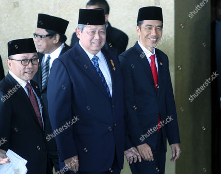 Indonesian President-elect Joko Widodo(r) Former Indonesian President Susilo Bambang Yudhoyono (c) and Indonesian Parliament Leader Zulkifli Hasan (l) Smile to the Journalists As They Go Inside the Parliament Building Shortly Before the Swearing in Ceremony of the Indonesian President-elect and Vice President-elect in Jakarta Indonesia 20 October 2014 the Ceremony is Being Attended by Foreign Leaders and Envoys Including Australian Prime Minister Tony Abbott and Us Secretary of State John Kerry Indonesia Jakarta