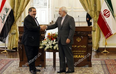 Iraqi Foreign Minister Hoshyar Zebari (l) Shakes Hands with His Iranian Counterpart Mohammad Javad Zarif (r) Following Their Joint Press Conference in Tehran Iran 26 February 2014 Zebari Denied Reports of an Arms Deal with Iran Adding That His Country Complies with International Regulations and Un Resolutions Iran ( Islamic Republic Of) Tehran