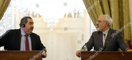 Iraqi Foreign Minister Hoshyar Zebari (l) and His Iranian Counterpart Mohammad Javad Zarif (r) During Their Joint Press Conference in Tehran Iran 26 February 2014 Zebari Denied Reports of an Arms Deal with Iran Adding That His Country Complies with International Regulations and Un Resolutions Iran ( Islamic Republic Of) Tehran