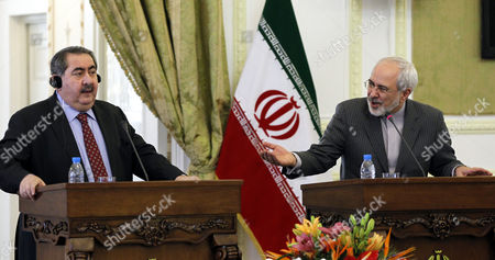 Iraqi Foreign Minister Hoshyar Zebari (l) Listens to His Iranian Counterpart Mohammad Javad Zarif (r) During Their Joint Press Conference in Tehran Iran 26 February 2014 Zebari Denied Reports of an Arms Deal with Iran Adding That His Country Complies with International Regulations and Un Resolutions Iran ( Islamic Republic Of) Tehran
