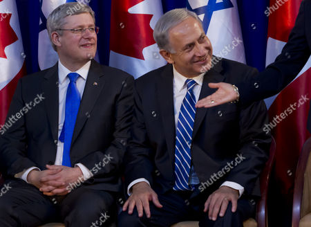 Canadian Prime Minister Stephen Harper with Israeli Prime Minister Benjamin Netanyahu (c) As Sarah Netanyahu (r) Gestures For Laureen Harper to Pass and Take Her Seat Next to Her Husband During the Canadian Leader's Official Welcoming Ceremony Under a Tent at the Prime Ministry in Jerusalem 19 January 2014 Harper is on a Four Day Visit to Israel and the Palestinian Authority Areas It is the First Such Trip by a Canadian Leader in a Decade Israel Jerusalem