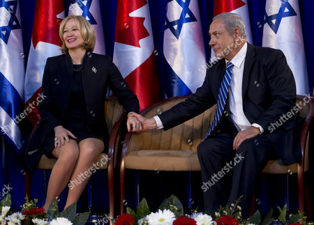 Laureen Harper (l) Wife of Canadian Prime Minister Stephen Harper Holds Hands with Israeli Prime Minister Benjamin Netanyahu As Her Husband Takes the Podium to Make a Brief Statement During the Canadian Leader's Official Welcoming Ceremony Under a Tent at the Prime Ministry in Jerusalem 19 January 2014 Harper is on a Four Day Visit to Israel and the Palestinian Authority Areas It is the First Such Trip by a Canadian Leader in a Decade Israel Jerusalem