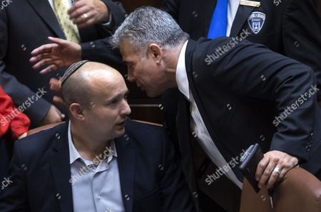 Yair Lapid (r) Israel's Finance Minister Sacked by Israeli Prime Minister Benjamin Netanyahu Talks with Naftali Bennet (l) Israeli Economy Minister and Head of the Far-right Jewish Home Or Bait Jehudit Party After the Vote to Dissolve the Government at the Knesset (parliament) in Jerusalem Israel 03 December 2014 Israeli Lawmakers Voted on a Bill Dispersing Parliament and Setting 17 March 2015 As the Date For Early Elections After Prime Minister Benjamin Netanyahu's Coalition Government Unraveled Over Disagreement on Key Policies Netanyahu Said a Day Earlier He was No Longer Able to Lead His Strained Coalition Just Two Years After It Took Office He Fired Two Centrist Ministers Opposed to His Policies Israel Jerusalem