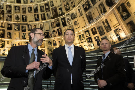 Stock Photo of The Prime Minister of Romania Victor-viorel Ponta (c) Looks Around in the Hall of Names in the Yad Vashem Holocaust Memorial in Jerusalem Israel 24 June 2014 As He Honors the Six-million Jews who Perished at the Hands of the Nazis During the Holocaust of World War Ii Israel Jerusalem