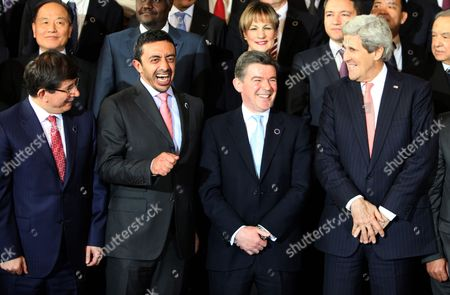 (l-r) Turkish Foreign Minister Ahmet Davutoglu Minister of Foreign Affairs of United Arab Emirates Abdullah Bin Zayed British Minister of State and Commonwealth Office of Uk Hugh Robertson and Us Secretary of State John Kerry Share a Light Moment As Ministers and Delegates Gather For a Family Photo Shoot at the End of the International Conference on Libya in Rome Italy 06 March 2014 Some 40-odd Participants Gathered For the One-day Talks in Rome Aimed at Mobilizing Support For Libya's Democratic Transition the Chief Diplomats of the United States and Russia Are Taking Part in the International Conference As Well As Foreign Ministers of Germany and France Libyan Leaders and Representatives of the United Nations Italy Rome