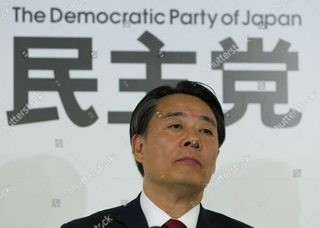 Banri Kaieda Leader of the Main Opposition Democratic Party of Japan (dpj) Listens As the Lower House Election Results Are Announced at the Party's Campaign Headquarters in Downtown Tokyo Japan 14 December 2014 the Ruling Liberal Democratic Party (ldp) and Its Coalition Partner Komeito Won the Landslide Victory Defeating the Dpj in the Elections Japan Tokyo