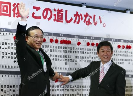 Sadakazu Tanigaki (l) Secretary-general of the Ruling Liberal Democratic Party (ldp) Puts a Red Rose Marks on Names of Candidates Winning the Lower House Election with Toshimitsu Motegi (r) Chairman of the Ldp's Election Strategy Committee at Headquarters of the Liberal Democratic Party in Tokyo Japan 14 December 2014 the Lower House Election Voted on 14 December and the Ruling Liberal Democratic Party and Its Coalition Partner Komeito Won the Landslide Victory in the Election Japan Tokyo