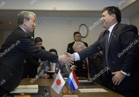 Stock Photo of Paraguayan President Horacio Cartes (r) Shakes Hands with Japan International Cooperation Agency (jica) President Akihiko Tanaka After Both Sides Signed an Official Development Agreement (oda) in Tokyo Japan 24 June 2014 Jica and Paraguay Signed a Japanese Oda Loan Agreement Cartes is Currently on a Four-day Visit to Japan Japan Tokyo