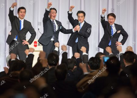 Stock Picture of (l-r) Democratic Party of Japan Candidate (dpj) Goshi Hosono Former Dpj Leader Banri Kaieda Newly Appointed Dpj Leader Katsuya Okada and Dpj Candidate Akira Nagatsuma Raise Their Hands Together During the Dpj Presidential Election in Downtown Tokyo Japan 18 January 2015 Katsuya Okada Former Foreign Minister Won the Dpj Presidential Election After Defeating Former Dpj Secretary General Goshi Hosono Whereas Former Health Minister Akira Nagatsuma was Ruled out During the First Round of Voting Okada's Newly Appointed Position is Set to Last Until 2017 September and Will Make an Effort to Regain Power From the Already Dominating Liberal Democratic Party (ldp) Japan Tokyo