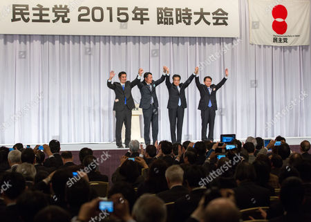 (l-r) Democratic Party of Japan Candidate (dpj) Goshi Hosono Former Dpj Leader Banri Kaieda Newly Appointed Dpj Leader Katsuya Okada and Dpj Candidate Akira Nagatsuma Raise Their Hands Together During the Dpj Presidential Election in Downtown Tokyo Japan 18 January 2015 Katsuya Okada Former Foreign Minister Won the Dpj Presidential Election After Defeating Former Dpj Secretary General Goshi Hosono Whereas Former Health Minister Akira Nagatsuma was Ruled out During the First Round of Voting Okada's Newly Appointed Position is Set to Last Until 2017 September and Will Make an Effort to Regain Power From the Already Dominating Liberal Democratic Party (ldp) Japan Tokyo