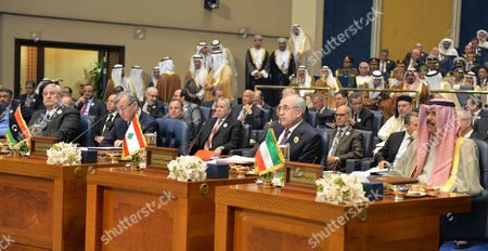 (l-r) Egypt's Interim President Adly Mansour Chairman of the Libyan General National Congress Nuri Abu Sahmain Lebanese President Michel Suleiman and Kuwaiti Crown Prince Sheikh Nawaf Al-ahmad Al-sabah Attend the Opening Session of the Arab Summit Meeting in Kuwait City Kuwait 25 March 2014 the Annual Arab League Summit Started on 25 March with a Rift Among Gulf States Expected to Sour the Meeting of Leaders in Kuwait the Crisis in Syria and Political Turmoil in Egypt Were High on the Agenda of the Summit Attended by 13 Heads of State and Other Leaders Kuwait Kuwait City