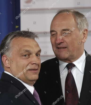 Stock Photo of Latvian President Andris Berzins (r) Welcomes Prime Minister of Hungary Viktor Orban (l) Before a Working Dinner For the Heads of Delegation on the Occasion of the Eastern Partnership Summit Hosted by the President of Latvia in Blackheads' House Riga Latvia 21 May 2015 Latvia Riga