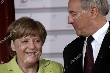 Latvian President Andris Berzins (r) Welcomes German Chancellor Angela Merkel Before a Working Dinner For the Heads of Delegation on the Occasion of the Eastern Partnership Summit Hosted by the President of Latvia in Blackheads' House Riga Latvia 21 May 2015 Latvia Riga