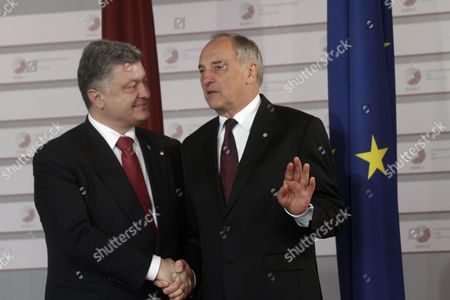 Latvian President Andris Berzins (r) Welcomes President of Ukraine Petro Poroshenko (l) Before a Working Dinner For the Heads of Delegation on the Occasion of the Eastern Partnership Summit Hosted by the President of Latvia in Blackheads' House Riga Latvia 21 May 2015 Latvia Riga