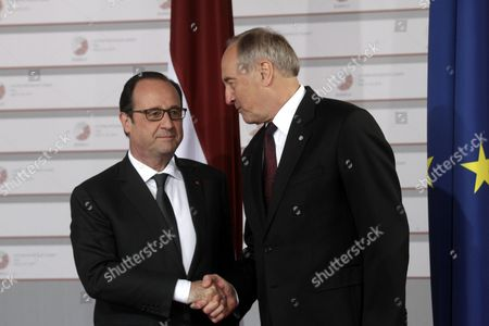 Latvian President Andris Berzins (r) Welcomes French President Francois Hollande Before a Working Dinner For the Heads of Delegation on the Occasion of the Eastern Partnership Summit Hosted by the President of Latvia in Blackheads' House Riga Latvia 21 May 2015 Latvia Riga