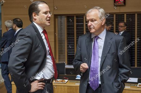 Swedish Finance Minister Anders Borg (l) Chats with Vice President of the European Commission in Charge of Economic and Monetary Affair Olli Rehn (r) Prior to the Eu Ecofin Council Meeting at the Eu Headquarters in Luxembourg 20 June 2014 the Minister's Council Will Be Called on to Adopt Decisions Closing the Excessive Deficit Procedures For Belgium the Czech Republic Denmark the Netherlands Austria and Slovakia It Will Thereby Confirm That These Countries Have Reduced Their Deficits Below 3 Per Cent of Gross Domestic Product (gdp) the Eu's Reference Value For Government Deficits Also the Ministers Will Discuss Country-specific Recommendations to the Member States on Their Economic and Fiscal Policies It is Expected to Endorse a Proposal to Allow Lithuania to Adopt the Euro As Its Currency As From 01 January 2015 Luxembourg Luxembourg