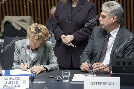 Swiss Finance Minister Eveline Widmer-schlumpf (l) and Austrian Finance Minister Hans Jorg Schelling (r) Sign an Agreement on Tax Issues During the Luxembourg Eu Ecofin Finance Ministers Meeting at Eu Headquarters in Luxembourg 14 October 2014 the Ministers Will Discuss Financial Supervision Regulation Sustainable Growth and Employment Eu Member States and Switzerland Are Expected to Sign a Joint Statement on Business Taxation Luxembourg Luxembourg