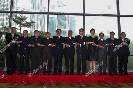 (l-r) Brunei Ministry of Finance Permanent Secretary Awang Nazmi Mohamad Cambodia Finance Minister Vongsey Vissoth Indonesia Finance Minister Bambang Permadi Soemantri Brodjonegoro Laos Finance Minister Liane Thykeo Myanmar Finance Minister Win Shein Malaysia Ii Finance Minister Ahmad Husni Mohamad Hanadzlah Philippines Finance Minister Cesar V Purisima Singapore Senior State Minister Josephine Teo Li Min Thailand Finance Minister Sommai Phasse Vietnam Finance Minister Dinh Tien Dung and Asean Deputy Secretary General Lim Hong Hin Pose For a Photo Session at the 19th Asean Finance Minister's Meeting in Kuala Lumpur Malaysia 21 March 2015 Malaysia Hosts the 19th Asean Finance Ministers Meeting in Kuala Lumpur Convention Centre Carrying the Theme of Our People Our Community Our Vision is Focus on Accelerating Efforts Towards Realising the Asean Economic Community From 19 to 21 March Malaysia Kuala Lumpur