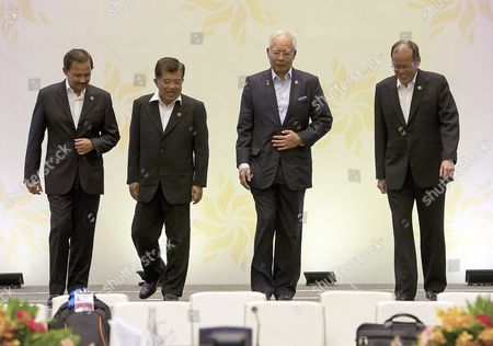 Association of South East Asian Nations (asean) Leaders (l-r) Sultan Hassanal Bolkiah of Brunei Vice President of Indonesia Jusuf Kalla Malaysia Prime Minister Najib Razak and Philippines President Benigno S Aquino Iii During a 11th Brunei-indonesia-malaysia-philippines East Asean Growth Area Summit of the 26th Asean Summit at Langkawi International Convention Centre Langkawi Malaysia 28 April 2015 the Two-day Summit of the 10-nation Bloc is Expected to Focus on Festering Disputes in the South-china Sea and Also Expected to Assess Initiatives For the Regional Single Market That is Scheduled to Begin at the End of the Year Malaysia Langkawi Island