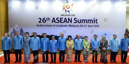 Stock Picture of (l-r) Philippine's President Benigno Aquino Singapore's Prime Minister Lee Hsien Loong Thailand's Prime Minister Prayut Chan-o-cha and His Wife Naraporn Vietnam's Prime Minister Nguyen Tan Dung Laos's Prime Minister Thongsing Thammavong Malaysia's Prime Minister Najib Razak and His Wife Rosmah Mansor Myanmar's President Thein Sein and His Wife Khin Khin Win Brunei's Sultan Hassanal Bolkiah and His Wife Queen Raja Isteri Pengiran Anak Hajah Saleha Cambodia's Prime Minister Hun Sen and Indonesia President Joko Widodo Pose For Group Photo Before the Gala Dinner in Honour of Asean Heads of State Pose For Photograph During the 26th Asean Summit in Kuala Lumpur on April 26 2015 the 10-member Nation Group Are Focusing on Furthering the Asean Community Integration Which Will Lead to a Single Market For the South-east Asian Region and Some Members Are Expected to Raise Territorial Disputes in the South China Sea Malaysia Kuala Lumpur