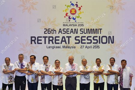 Association of South East Asian Nations (asean) Leaders Hold Hands For the Traditional Asean Handshake (l-r) Philippines President Benigno S Aquino Iii Prime Minister of Singapore Lee Hsien Loong Prime Minister of Thailand General Prayut Chan-o-cha Prime Minister of Vietnam Nguyen Tan Dung Prime Minister of Laos Thongsing Thammavong Malaysia Prime Minister Najib Razak President of Myanmar Thein Sein Sultan Hassanal Bolkiah of Brunei Prime Minister of Cambodia Hun Sen and Vice President of Indonesia Jusuf Kalla During a Retreat Session of the 26th Asean Summit at Langkawi International Convention Centre Langkawi Malaysia 27 April 2015 the Two-day Summit of the 10-nation Bloc is Expected to Focus on Festering Disputes in the South-china Sea and Also Expected to Assess Initiatives For the Regional Single Market That is Scheduled to Begin at the End of the Year Malaysia Langkawi Island