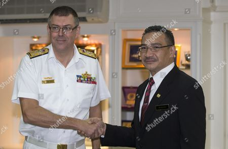 Visiting Australian Navy Chief Vice Admiral Ray Griggs (l) Shakes Hands with Malaysian Drefense Minister and Acting Transport Minister Hishammuddin Hussein (r) During His Visit at the Defense Ministry in Kuala Lumpur Malaysia 12 May 2014 Griggs is in Malaysia on a Three-day Visit Malaysia Kuala Lumpur