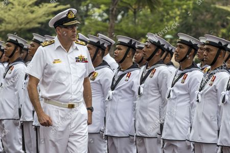 Stock Picture of Visiting Australian Navy Chief Vice Admiral Ray Griggs (l) Inspects Malaysia's Guard of Honor During His Visit at the Defense Ministry in Kuala Lumpur Malaysia 12 May 2014 Griggs is in Malaysia on a Three-day Visit Malaysia Kuala Lumpur