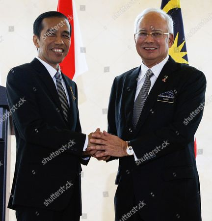 Malaysia Prime Minister Najib Razak (r) Shaking Hands with President of the Republic of Indonesia Joko Widodo (l) After Joint Press Conference at Perdana Putra Complex Putrajaya Malaysia 06 Febuary 2015 Joko Widodo is on a Three-day Visit to Malaysia From 5 to 7 Febuary by Invitation of His Majesty the Yang Di-pertuan Agong (king's of Malaysia) This Will Be His First Bilateral Visit to Malaysia Following His Appointment As the President of Republic of Indonesia Malaysia Sepang