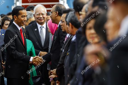 The President of the Republic of Indonesia Joko Widodo (l) and Malaysia's Prime Minister Najib Razak (c) Shaking Hands with Diplomats at the Bunga Raya Lounge of the Kuala Lumpur International Airport in Sepang Malaysia 05 Febuary 2015 Joko Widodo is on a Three-day Visit to Malaysia From 05 to 07 Febuary by Invitation of His Majesty the Yang Di-pertuan Agong the King of Malaysia This Will Be His First Bilateral Visit to Malaysia Following His Appointment As the President of Republic of Indonesia Malaysia Sepang