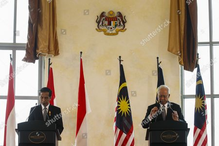 The Malaysian Prime Minister Najib Razak (r) and President of the Republic of Indonesia Joko Widodo (l) Arrive For a Joint Press Conference at Perdana Putra Complex Putrajaya Malaysia 06 Febuary 2015 Joko Widodo is on a Three-day Visit to Malaysia From 5 to 7 Febuary by Invitation of His Majesty the Yang Di-pertuan Agong (king's of Malaysia) This Will Be His First Bilateral Visit to Malaysia Following His Appointment As the President of Republic of Indonesia Malaysia Sepang