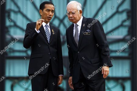 Malaysia Prime Minister Najib Razak (r) Speaks to President of the Republic of Indonesia Joko Widodo (l) in Perdana Putra Complex Putrajaya Malaysia 06 Febuary 2015 Joko Widodo is on a Three-day Visit to Malaysia From 5 to 7 Febuary by Invitation of His Majesty the Yang Di-pertuan Agong (king's of Malaysia) This Will Be His First Bilateral Visit to Malaysia Following His Appointment As the President of Republic of Indonesia Malaysia Sepang