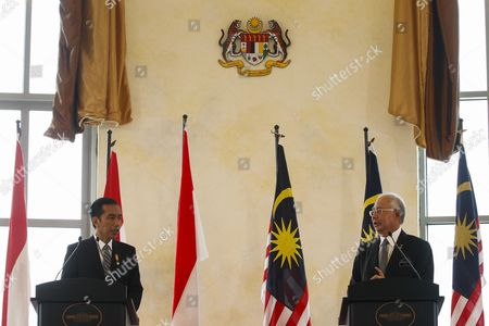 President of the Republic of Indonesia Joko Widodo (l) Gives a Speech Accompanied by Malaysian Prime Minister Najib Razak (r) During a Joint Press Conference at Perdana Putra Complex Putrajaya Malaysia 06 Febuary 2015 Joko Widodo is on a Three-day Visit to Malaysia From 5 to 7 Febuary by Invitation of His Majesty the Yang Di-pertuan Agong (king's of Malaysia) This Will Be His First Bilateral Visit to Malaysia Following His Appointment As the President of Republic of Indonesia Malaysia Sepang
