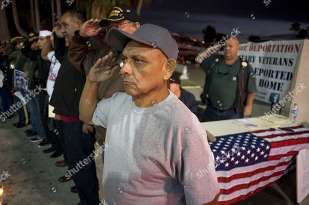 United States Army Veteran Ricardo Avila Torres 59 who Had Been Deported to Mexico in 1996 Salutes with Other Veterans and Supporters During a Protest on Veteran's Day at the Us-mexico Border Crossing in Tijuana Mexico 11 November 2014 the Protestors Were Demanding Reform to Immigration Laws That Would Allow Them to Receive Benefits While in Mexico and to Also Allow Them to Seek Re-entry to the United States Avila Served in Vietnam Mexico Tijuana