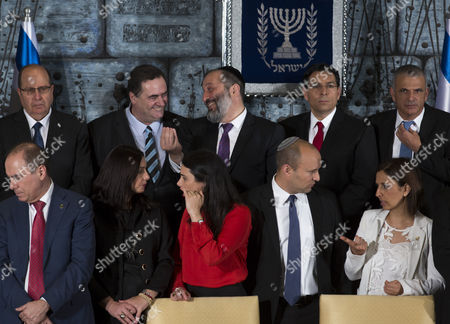 Stock Image of Ministers in the 34th Israeli Government Chat Before the Arrival of Prime Minister Benjamin Netanayhu and President Reuven Rivlin As the Government Meets For the Formal 'Family Photograph' in the Jerusalem Residence of President Rivlin 19 May 2015 (l-r) Front Are: Silvan Shalom Deputy Prime Minister and Minister of the Interior Miri Regev Minister of Culture and Sport Ayelet Shaked (red Blouse) Justice Minister Naftali Bennet Minister of Education and Minister of Diaspora Affaris and Gila Gamiel Minister of Pensioner Affairs and Minister of Gender Equality Behind Are L to R; Moshe Ya'alon Defense Minister Yisrael Katz Minister of Transportation and Minister of Intelligence Arye Deri Minister of Economy and Minister For the Development of the Negev and Galilee Danny Danon Minister of Science Technology and Space and Moshe Kahlon Minister of Finance the New Government Has 20 Ministers in Total and not All in This Photograph Netanyahu Retains the Posts of Minister of Foreign Affairs Minister of Communications Minister of Regional Cooperation and Minister of Health Israel Jerusalem