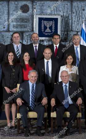 Stock Picture of Israeli Prime Minister Benjamin Netanyahu (seated L) Next to Israeli President Reuven Rivlin As They Pose For the Formal 'Family Photograph' in the President's Jerusalem 19 May 2015 5 Standing in Second Row L to R Are: Miri Regev Minister of Culture and Sport Ayelet Shaked (red Blouse) Justice Minister Naftali Bennet Minister of Education and Minister of Diaspora Affaris and Gila Gamiel Minister of Pensioner Affairs and Minister of Gender Equality in Third Row L to R Are: Yisrael Katz Minister of Transportation and Minister of Intelligence Arye Deri Minister of Economy and Minister For the Development of the Negev and Galilee Danny Danon Minister of Science Technology and Space and Moshe Kahlon Minister of Finance the New Government Has 20 Ministers in Total and not All in This Photograph Netanyahu Retains the Posts of Minister of Foreign Affairs Minister of Communications Minister of Regional Cooperation and Minister of Health Israel Jerusalem