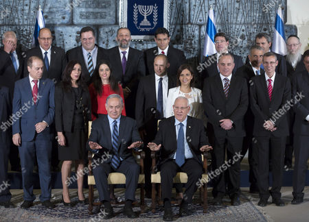 Israeli Prime Minister Benjamin Netanyahu (seated L) Next to Israeli President Reuven Rivlin As They Pose For a Family Photograph with Israel's 34th Government in the Jerusalem Residence of President Rivlin 19 May 2015 Behind the Prime Minister From Left Are: Silvan Shalom Deputy Prime Minister Miri Regev Minister of Culture and Sport Ayelet Shaked Justice Minister Naftali Bennet Minister of Education and Minister of Diaspora Affaris Gila Gamiel Minister of Pensioner Affairs and Minister of Gender Equality Yuval Steinitz Minister of Energy and Water Yariv Levin (1st Row R) Minister of Tourism and Minister of Public Security Moshe Kahlon (behind R Partial Hidden) Minister of Finance Back Row Standing From L to R: Unidentified Moshe Ya'alon Defense Minister Yisrael Katz Minister of Transportation and Minister of Intelligence Arye Deri Minister of Economy Minister For the Development of the Negev and Galilee Danny Danon Minister of Science Technology and Space Ofir Akunis 'Ministerial Post' in Communications Zeev Elkin Minister of Immigrant Absorption and Minister of Strategic Affairs and Yaacov Litzman Deputy Minister of Health the New Government Has 20 Ministers in Total and not All in This Photograph Israel Jerusalem