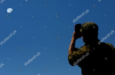 Stock Image of An Israeli Takes Pictures with His Mobil Phone of a Missile Launched From the Gaza Strip Being Intercepted by the Israeli Irone Dome Defense System at the Israeli Border with the Gaza Strip Southern Israel 10 July 2014 Intense Israeli Airstrikes Continued Overnight Throughout the Gaza Strip where Black Pillars of Smoke Have Been Rising Since Israel Launched Operation Protective Edge in Response to an Escalation in Rocket Attacks From the Salient Reports Say That More Than 60 Palestinians Have Died Since the Israeli Airstrikes Began on 08 July Israel Israeli Gaza Border