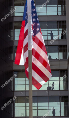 A Us Flags Flies As Workers Inside the Israeli Military Headquarters Watch Proceedings During a Ceremony Honoring Visiting Chairman of the United States Joint Chiefs of Staff Gen Martin E Dempsey at the Israeli Military Headquarters in Tel Aviv Israel 09 June 2015 Dempsey's Tenure As the Usa's Leading Military Officer is Coming to a Close and He was Honored by Israel and Awarded a Medal Israel Tel Aviv