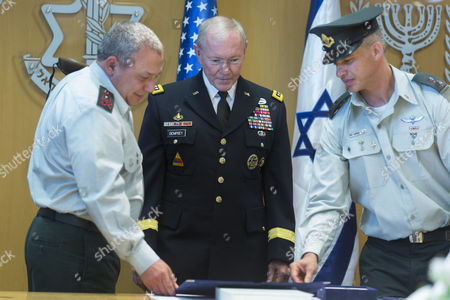 Chairman of the United States Joint Chiefs of Staff Gen Martin E Dempsey (c) with Israeli Chief of Staff Lieutenant General Gadi Eizenkot (l) and an Unidentified Israeli Officer As He Receives a Medal From Israel During a Ceremony at Israel's Military Headquarters in Tel Aviv Israel 09 June 2015 Honoring Dempsey's Tenure As the Usa's Leading Military Officer As His Term Comes to a Close Dempsey Said There was No Country in the World Standing So Firmly Behind Israel Israel Tel Aviv
